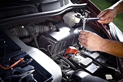 Professional working on the repair of automobile in Sheffield