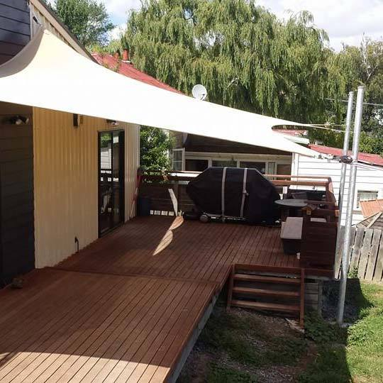 house with awning in backyard