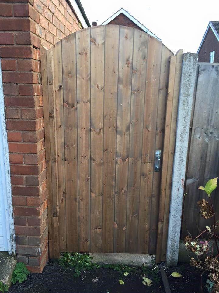 tall wooden gate