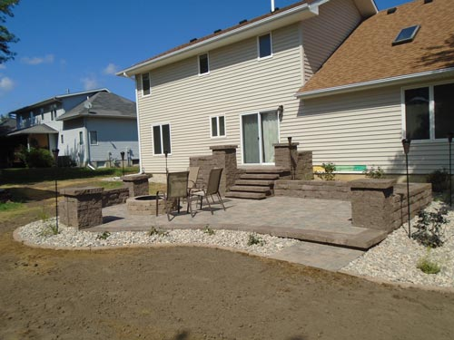 new fire pit, brown stone patio