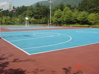 basketball pitch marked out in white on blue surface