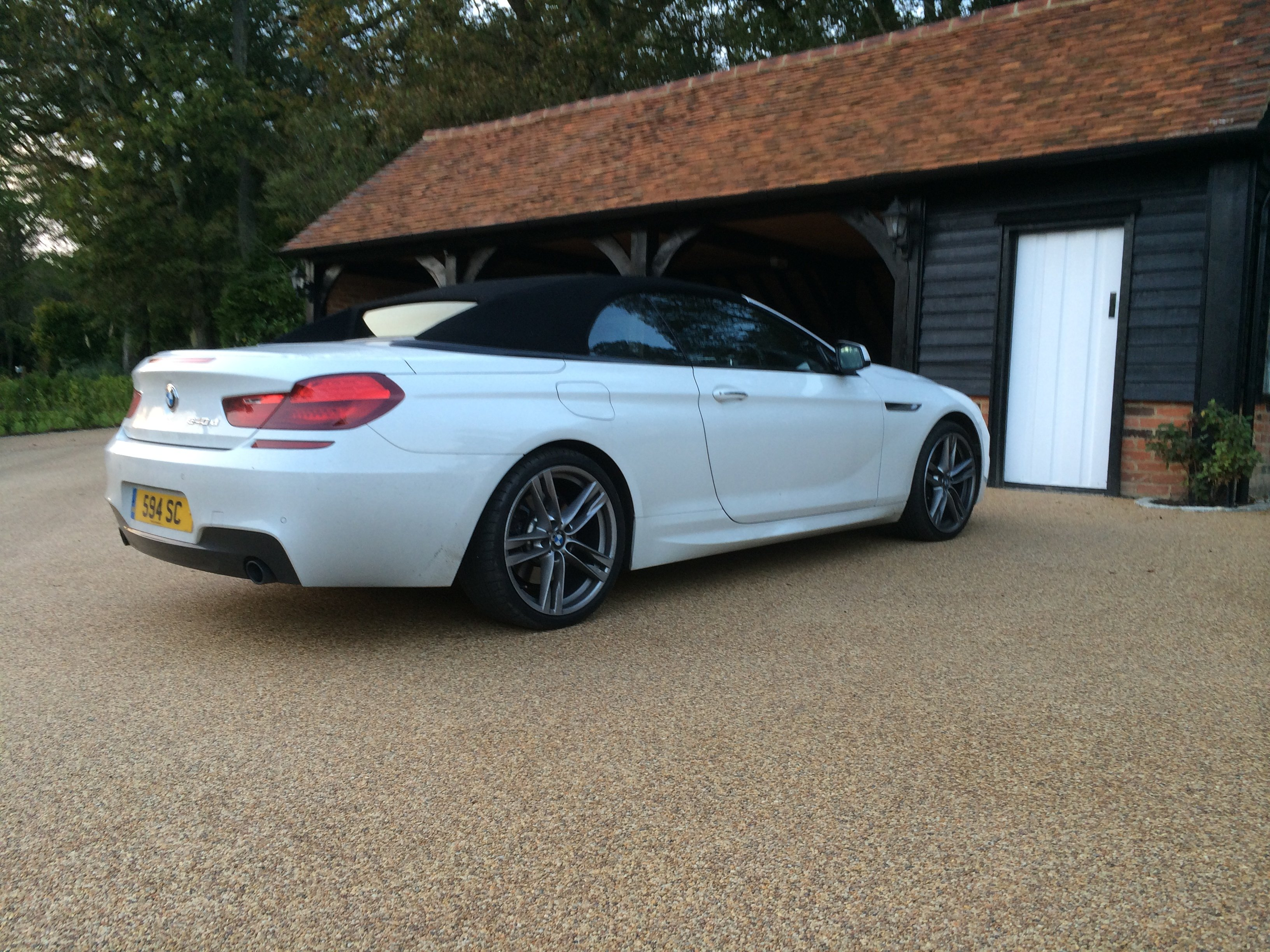 resin paved garage approach with white BMW car