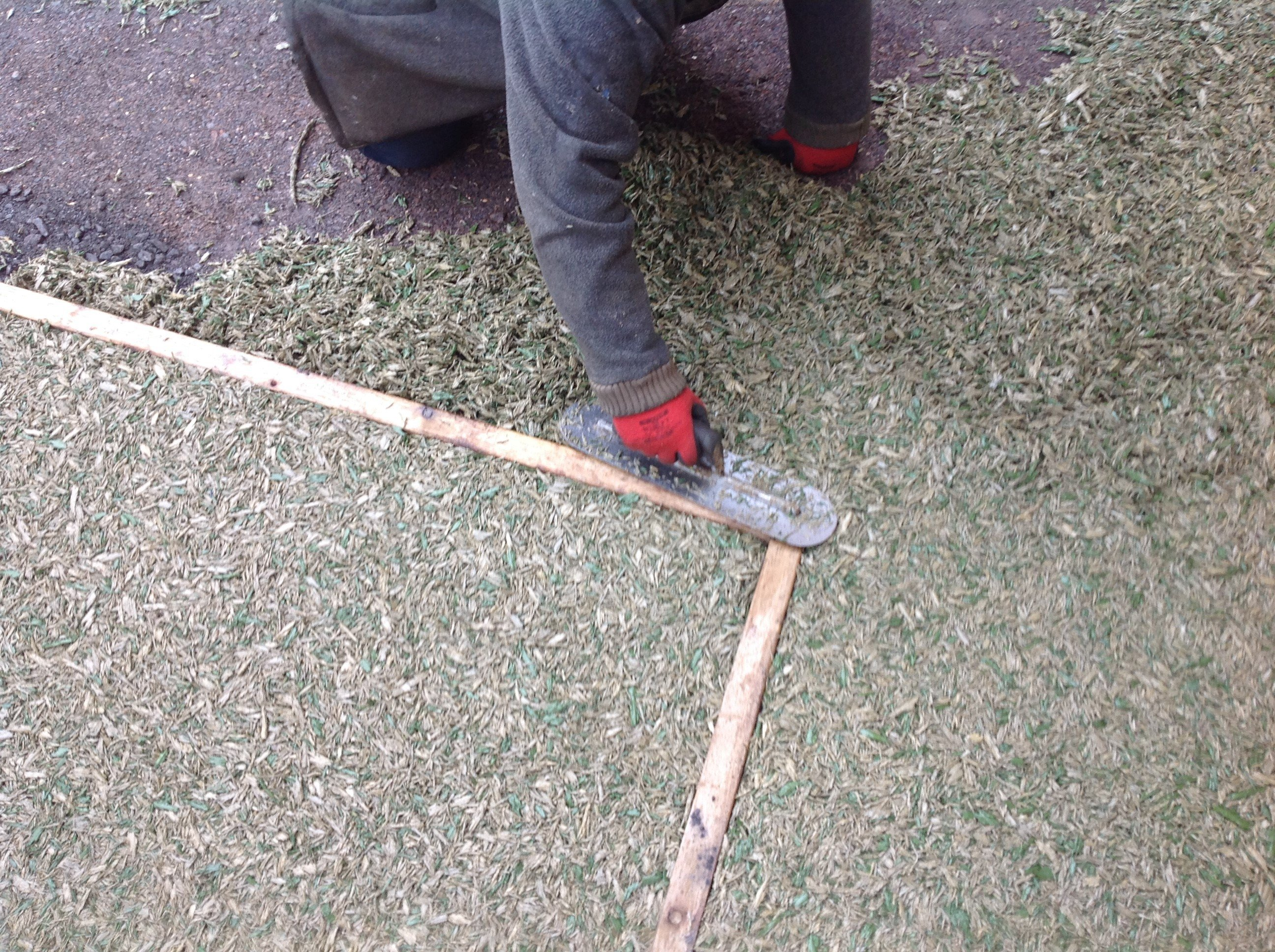 laying a rubber mulch safety play surface
