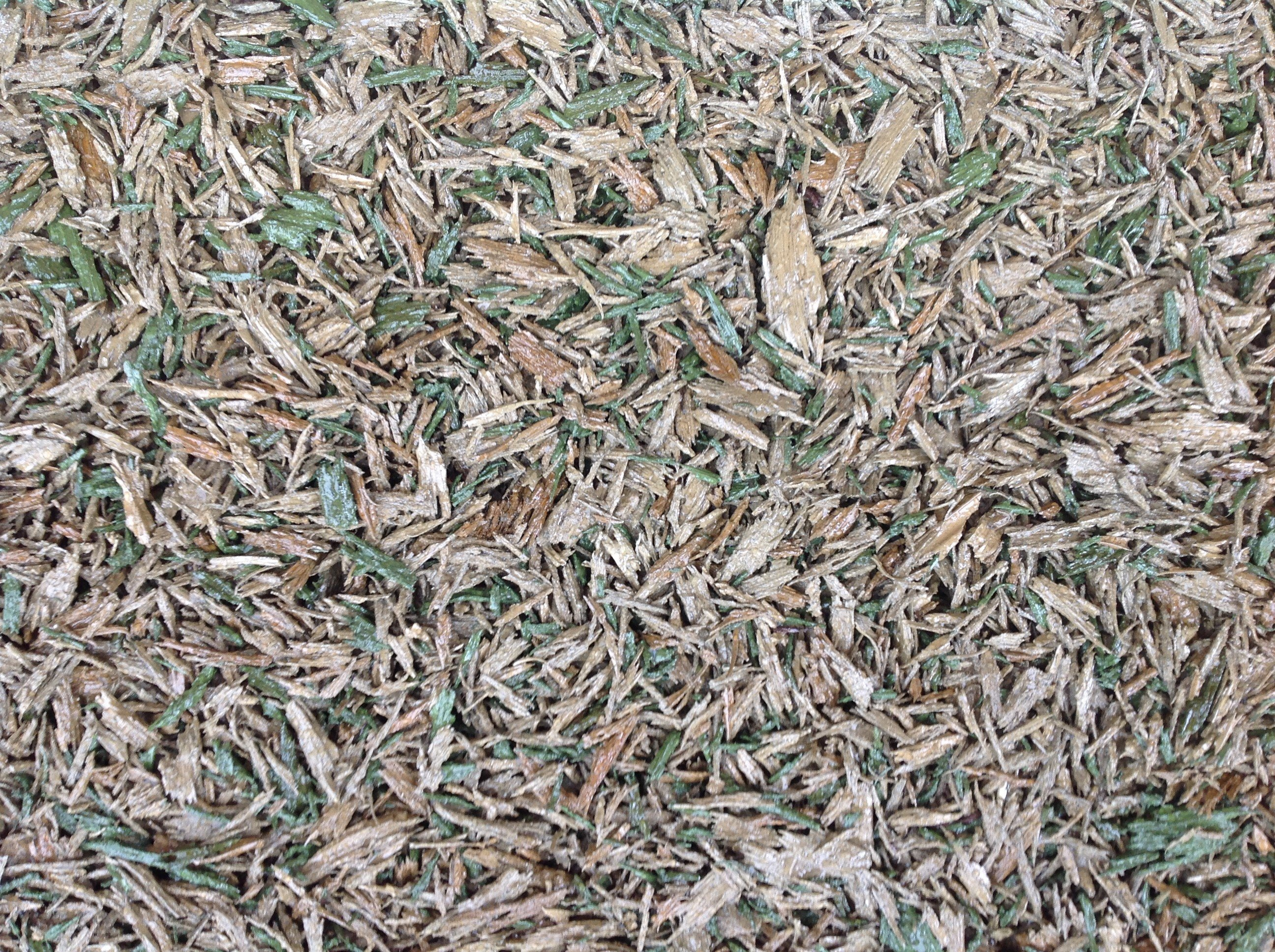 rubber mulch surface in natural greens and browns