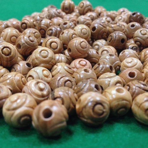 perline in legno scalfite