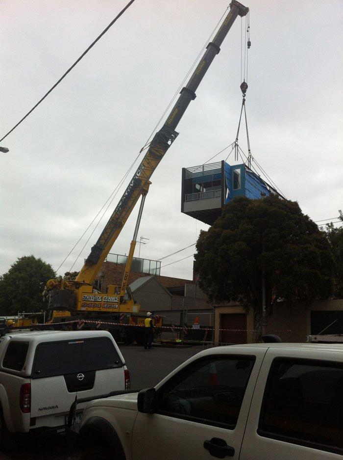 crane delivering building