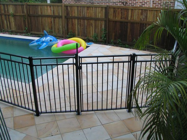 View of tubular fencing by the pool