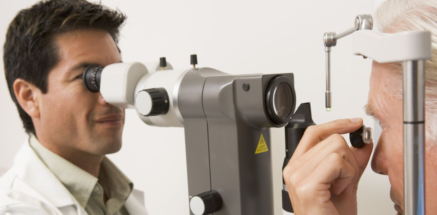 An eye doctor measures eyesight of a patient in Bullhead City, AZ
