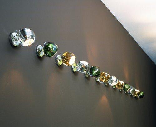 lampade a muro di color verde,arancione e argento
