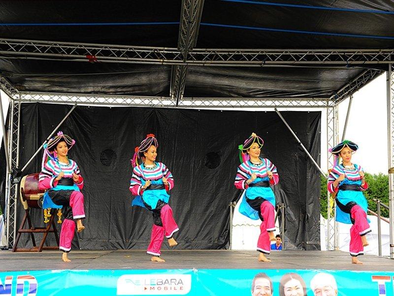dancers in blue attire