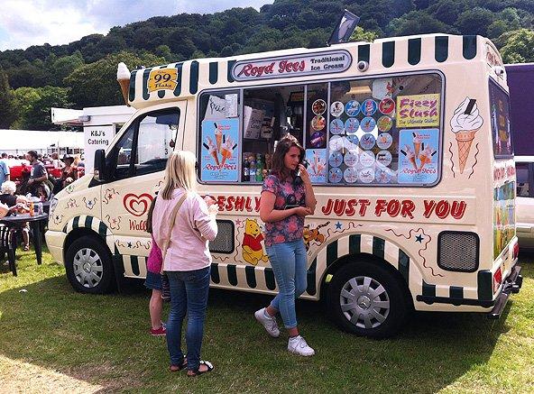 Girl standing outside ice cream van