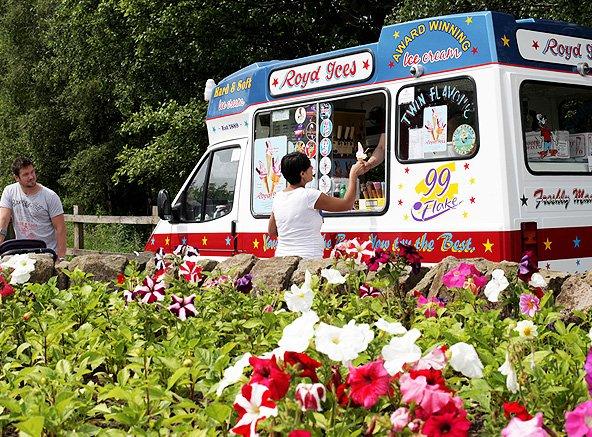 Customer buying ice cream from a Royd Ices' ice cream van