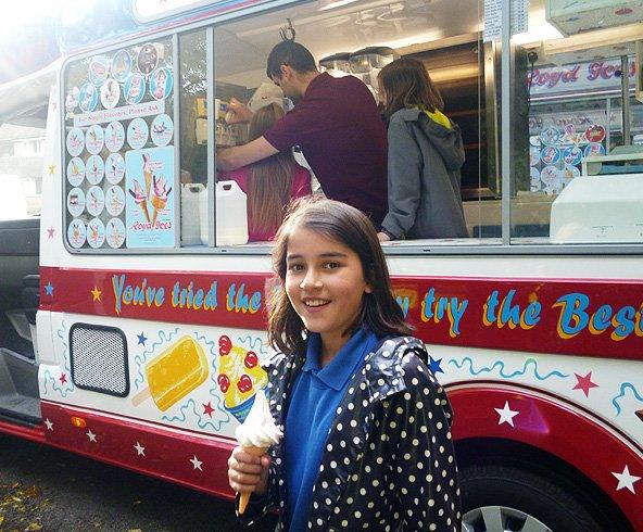Happy little girl holding an ice cream