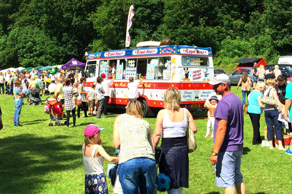 Lots of people queuing for ice cream from the van