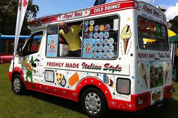 Happy worker smiling in the ice cream van