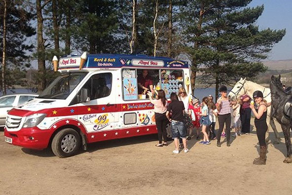 Happy customers buying ice cream from Royd Ices
