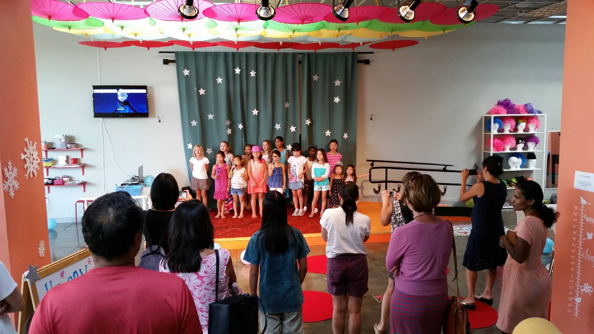 kids singing in front of parents
