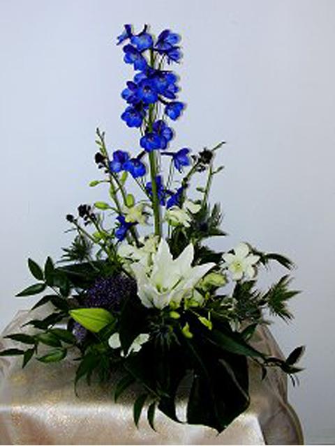 Blue arrangement in container