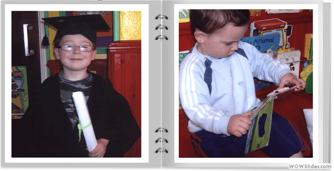 A small child in graduation gown and a young boy reading