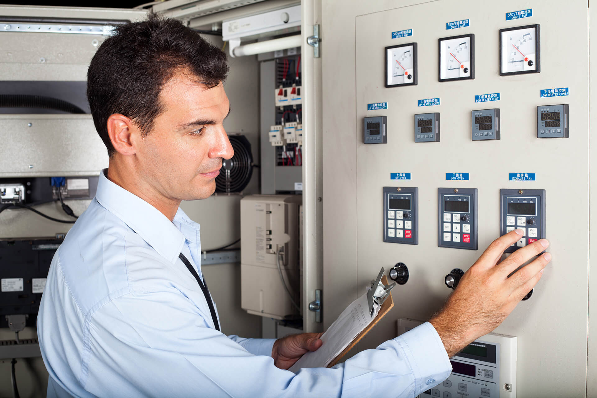 Specialized man checking electricity panel