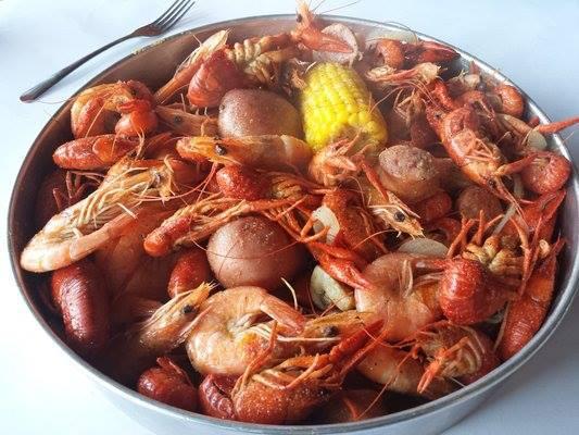 plate of crawfish, shrimp, potatoes, corn, mushrooms