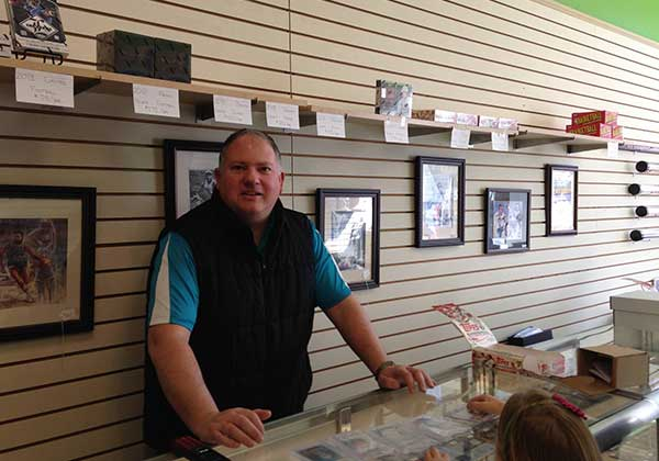 Owner behind the counter at Neuhart Cards & Sports Collectibles in Delaware
