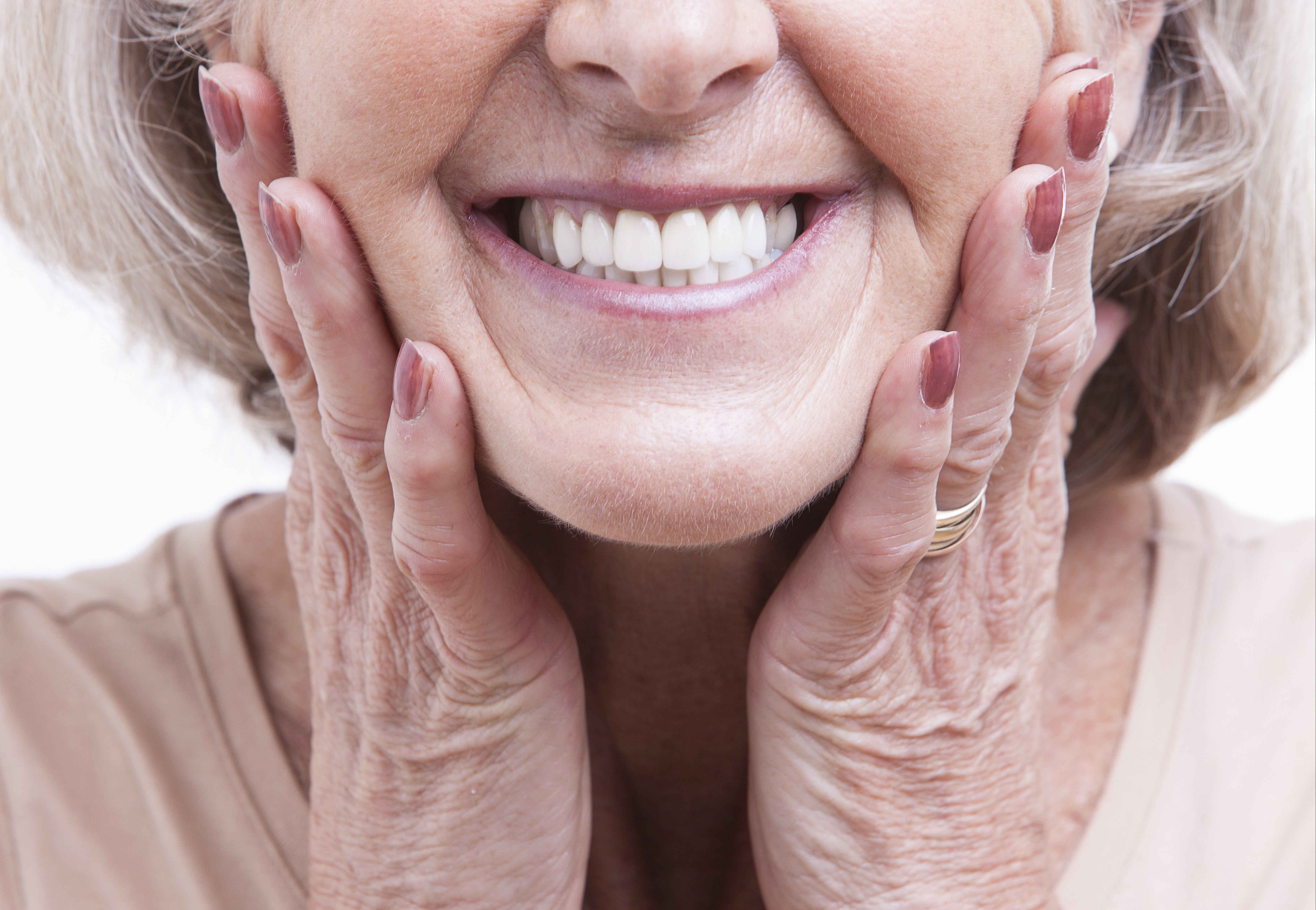 Mature Woman Smiling With Hands on Cheeks