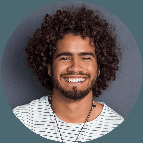 Young Hispanic Man Smiling