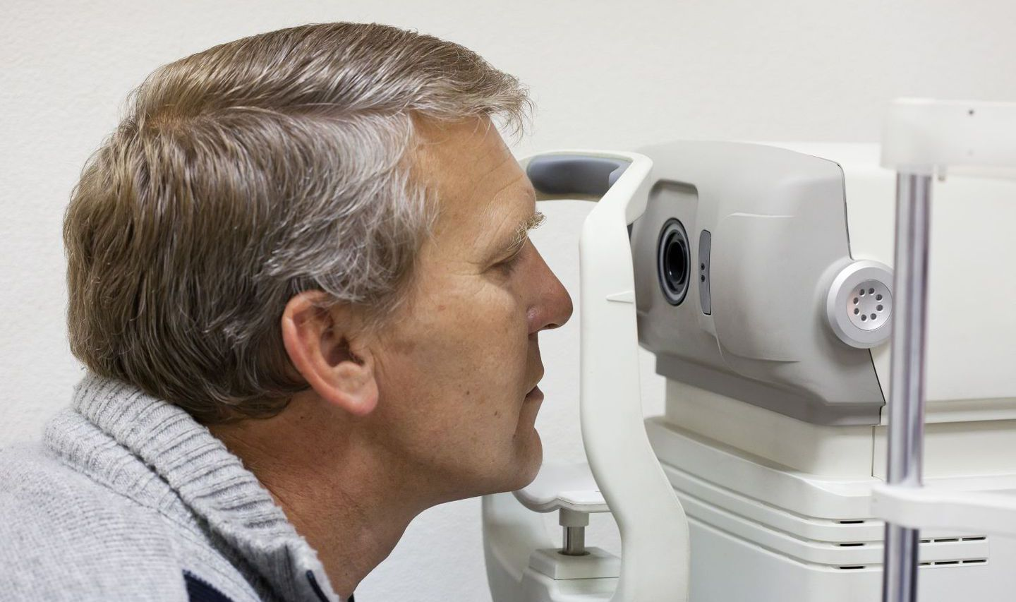 An optometrist is performing an exam in High Point, NC