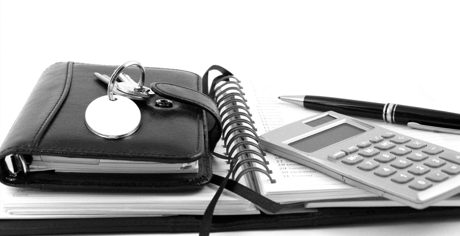 agenda, wallet, keys, pen and calculator branch law firm