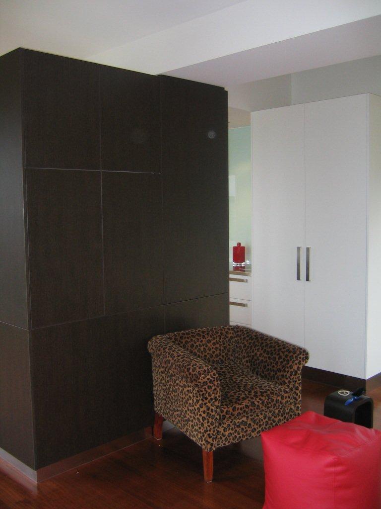 storage cabinet behind chair