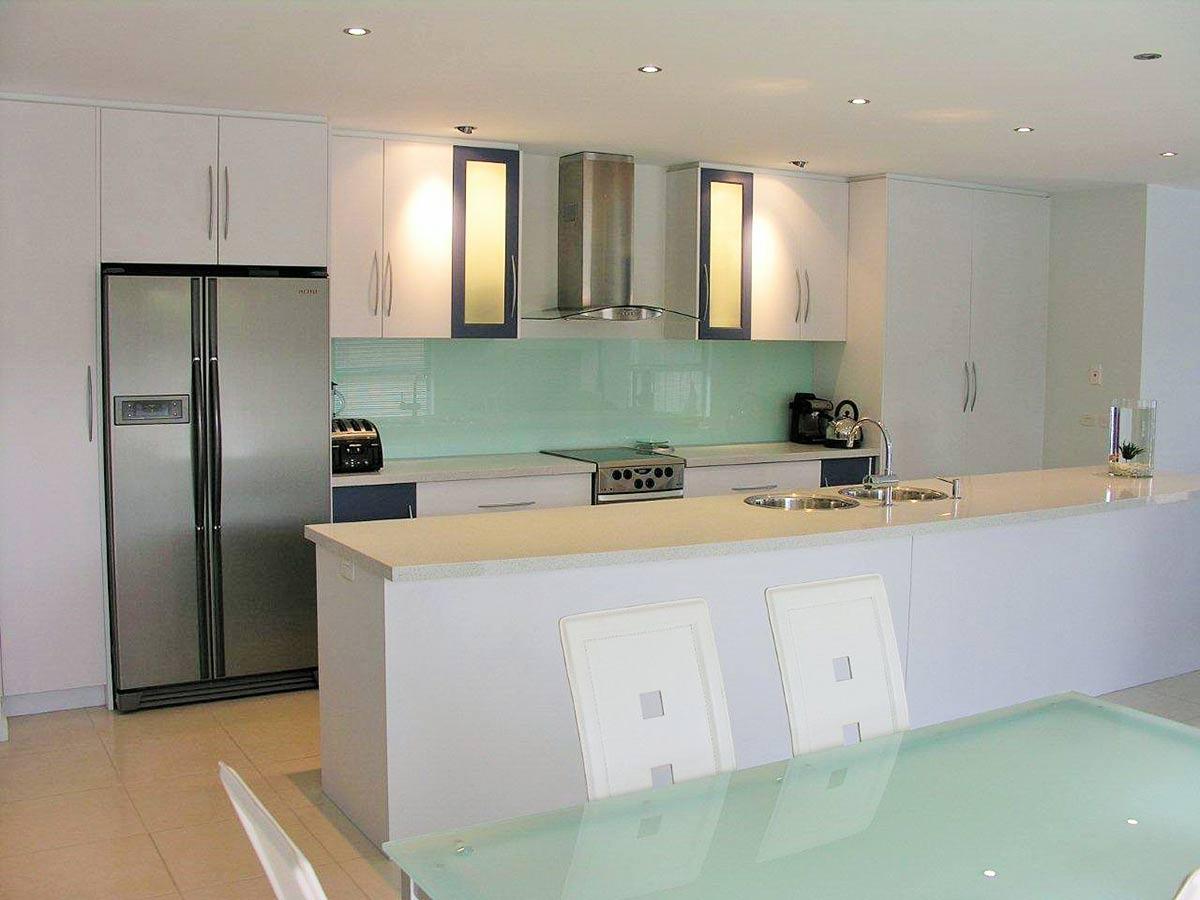 kitchen with blue elements alternate view
