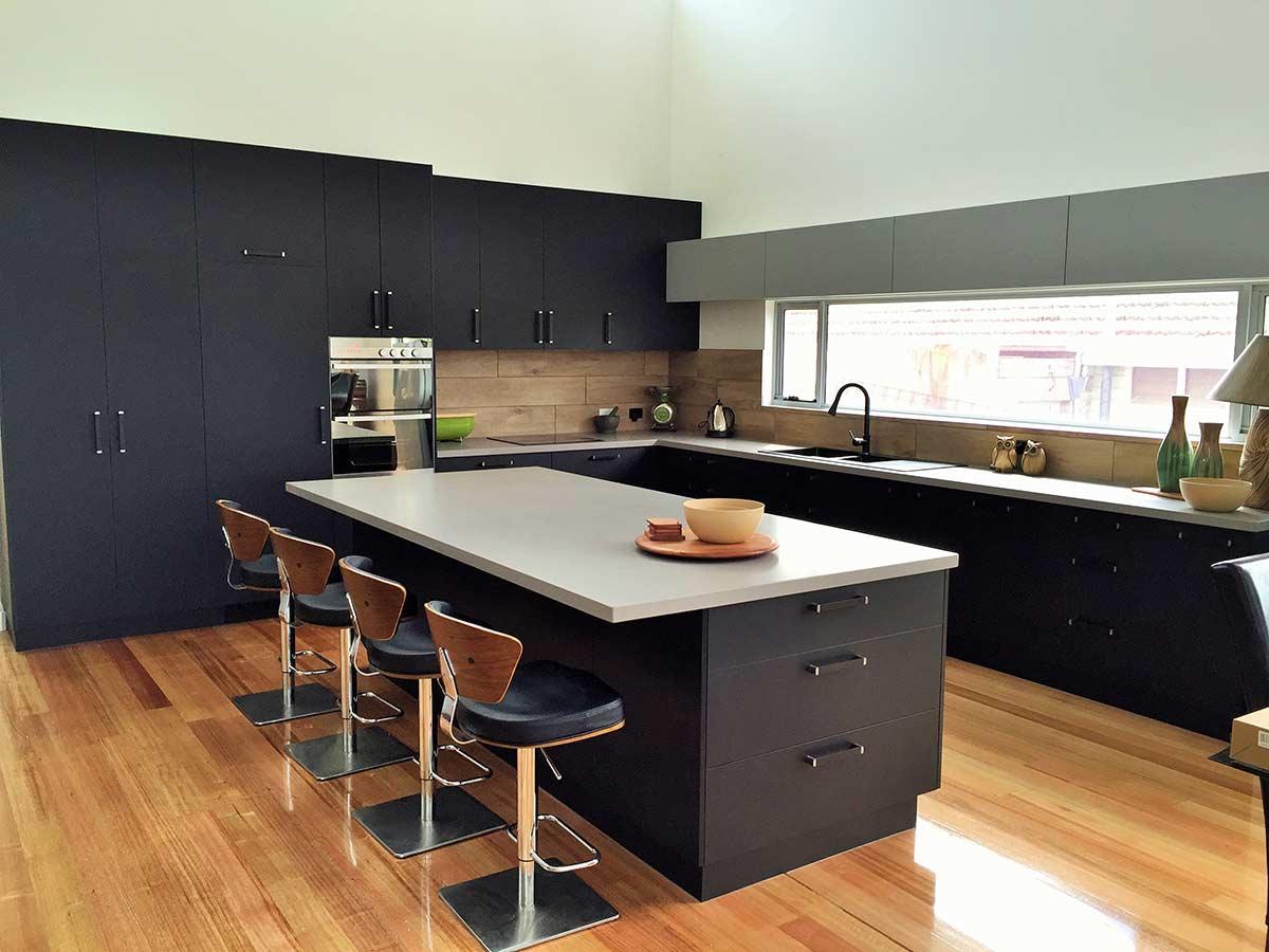 black kitchen with red flooring