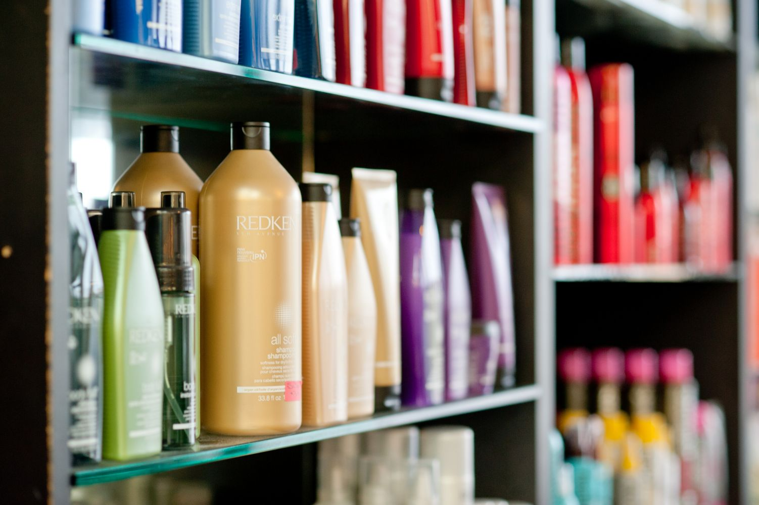 Various haircare products displayed on a shelf