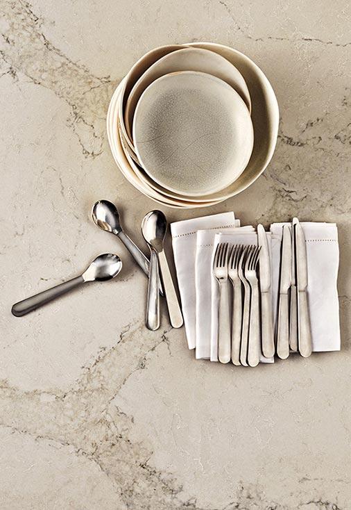 amalgamated stone pty ltd plates and spoon on marble