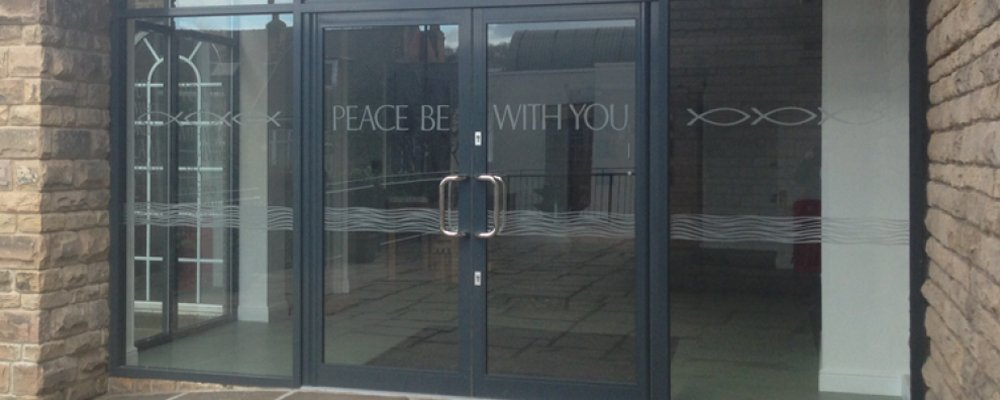 Glass door with engraving