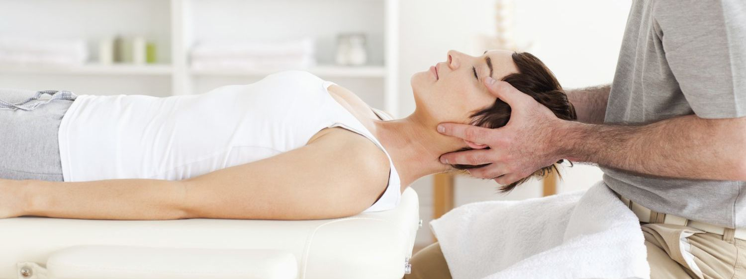 Woman receives chiropractic care in Foley, AL