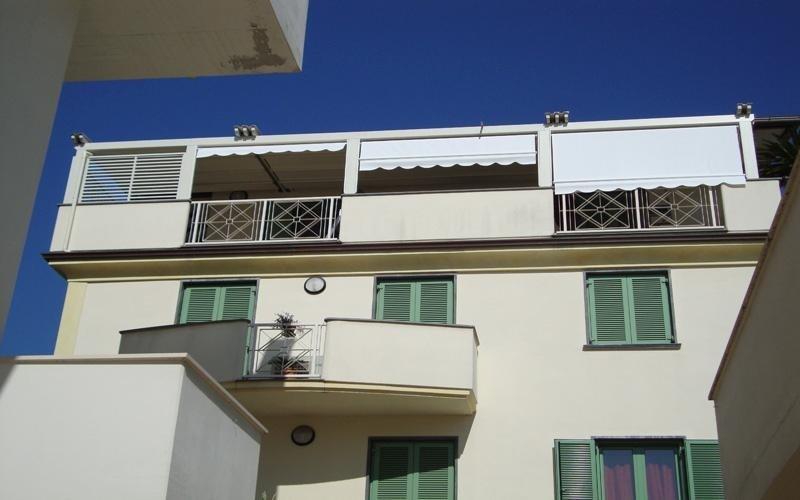 chiusure verticali balconi pisa