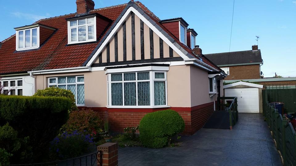 house with a triangle shape roof