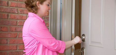 Woman opening lock provided by locksmith services experts in Kingman, AZ