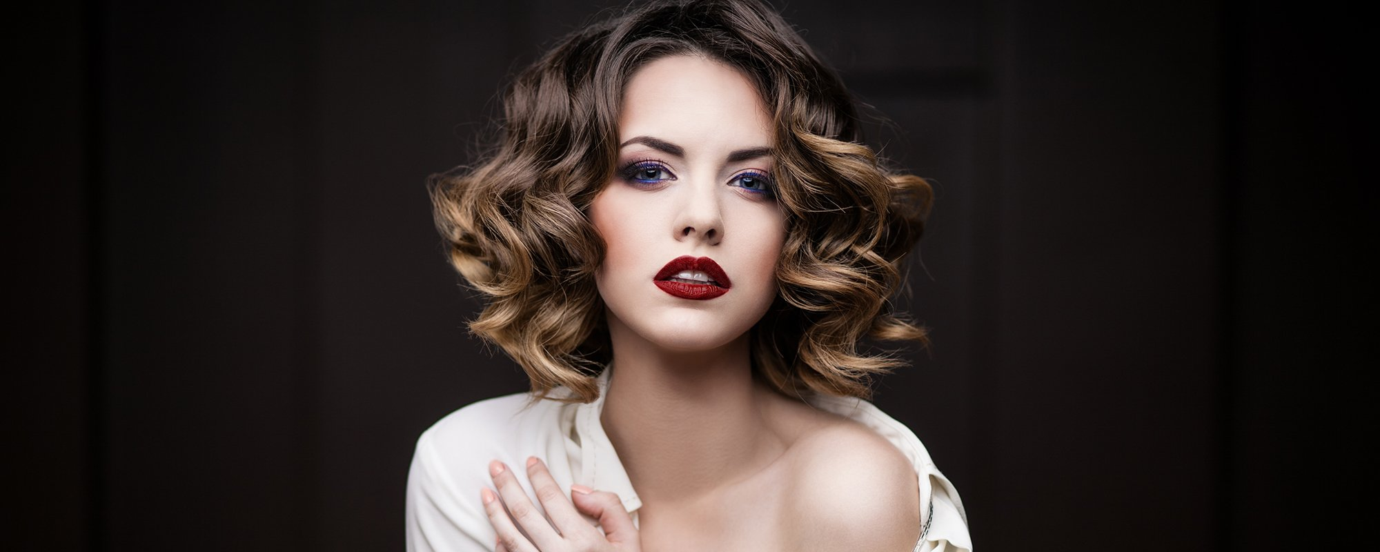View of women with curled hair styled by A Cut Above hairdressers