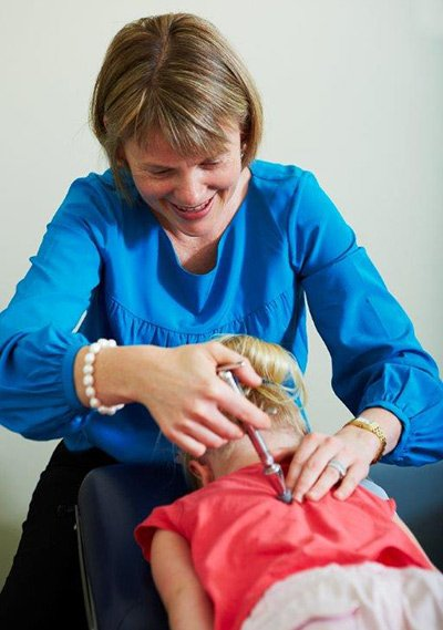 global chiropractic doing massage for child