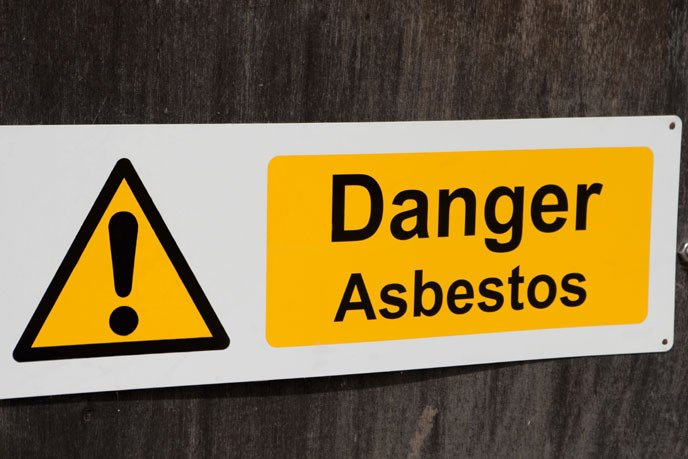 A warning sign that reads: Danger Asbestos
