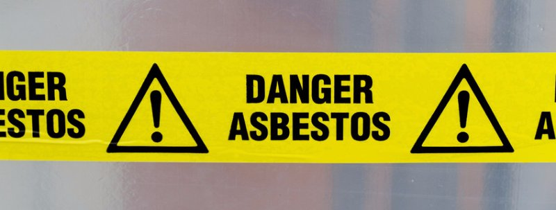 A sign that reads DANGER ASBESTOS