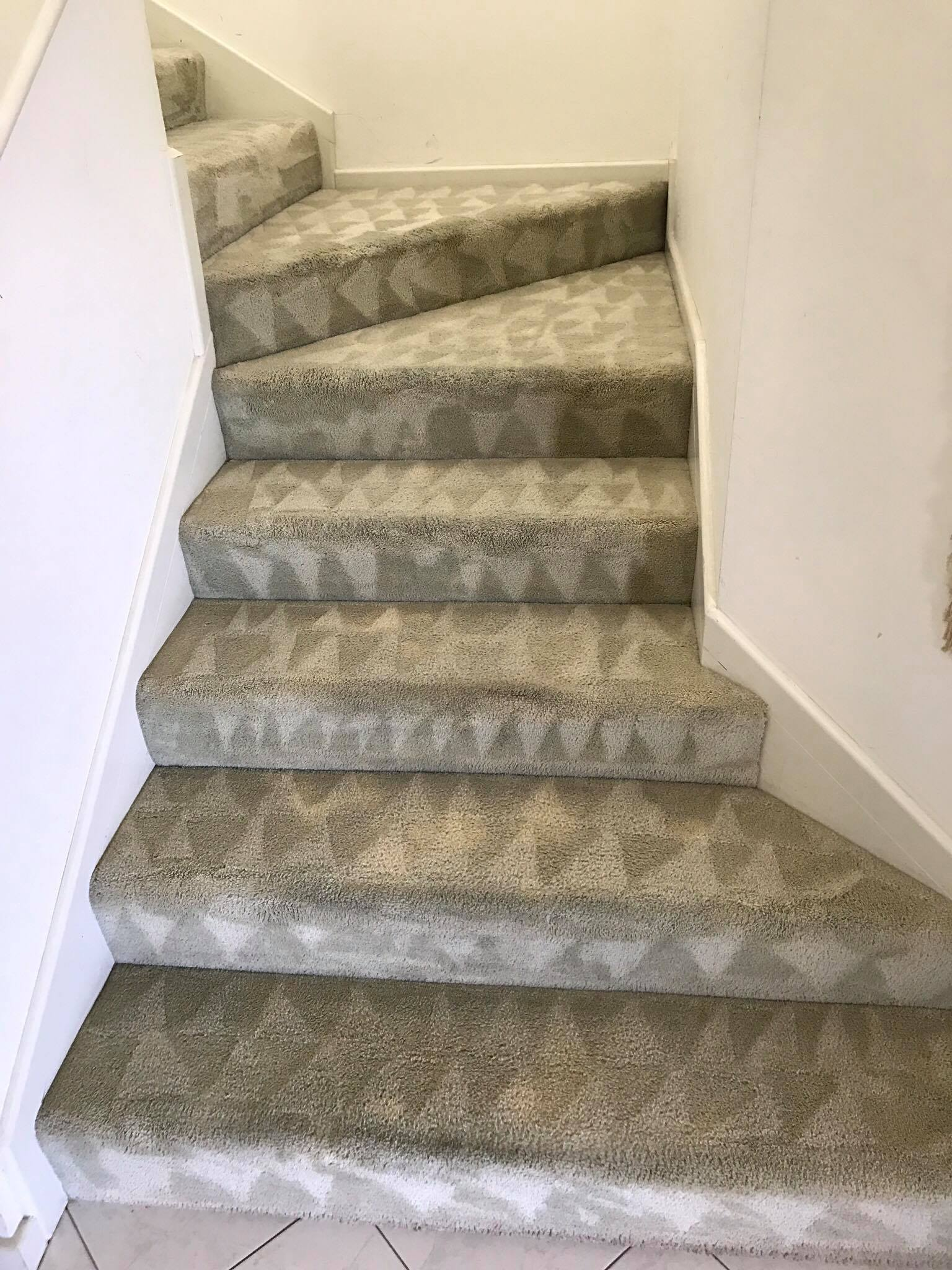 View of stairway carpet before cleaning