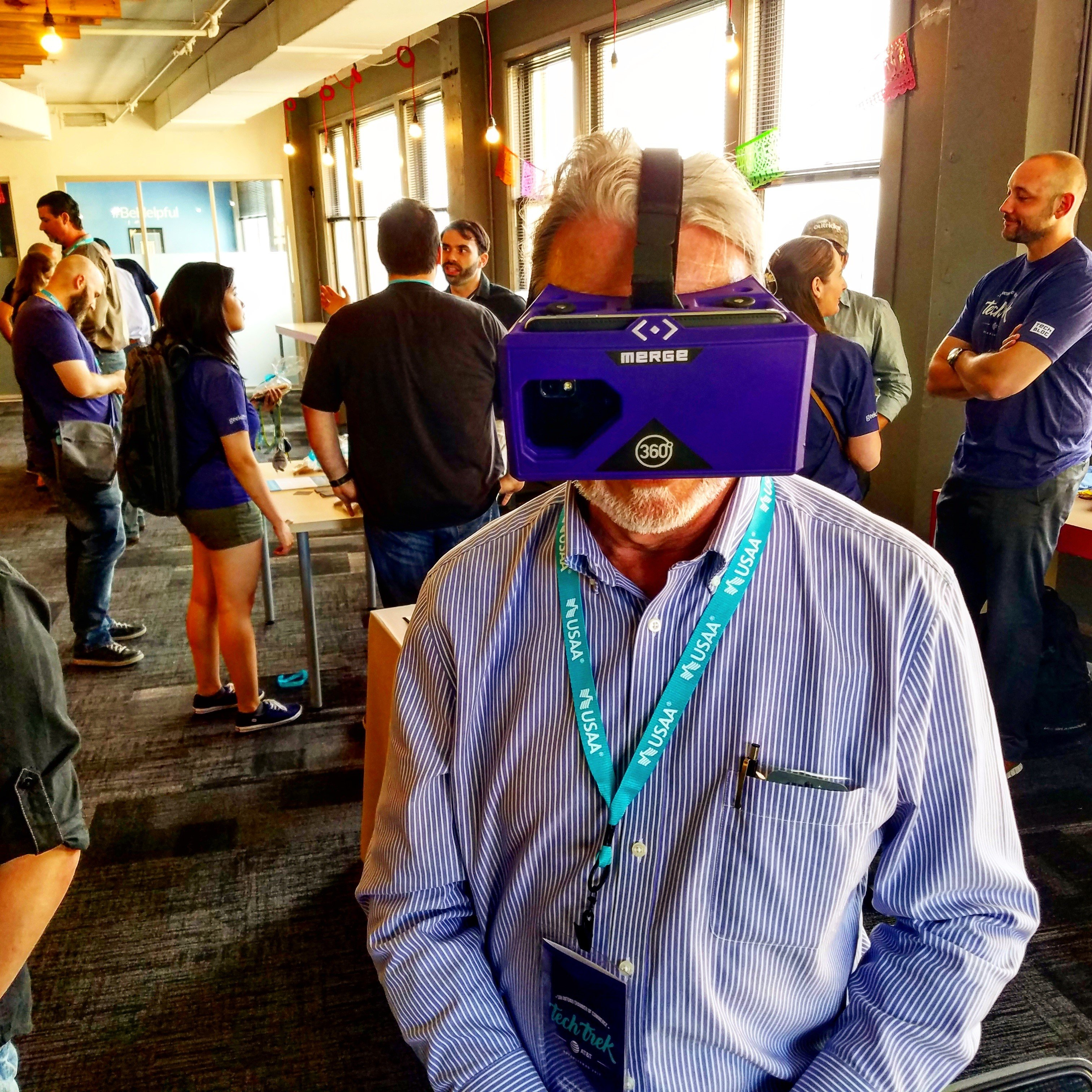 San Antonio resident views new doublewide mobile home using VR goggles.