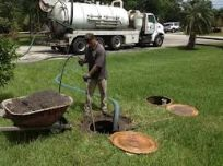 Worker performing a Septic Tank Inspection in Princeton, WV