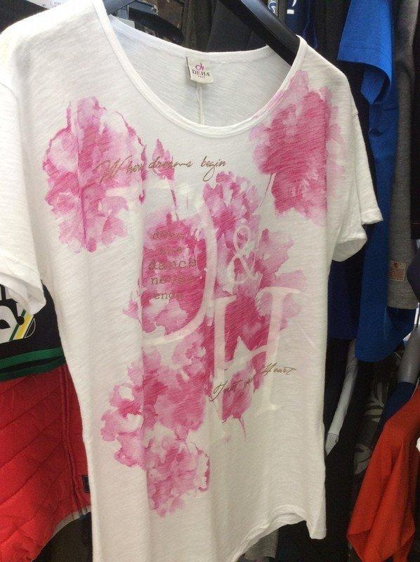 una maglietta bianca con dei fiori rosa