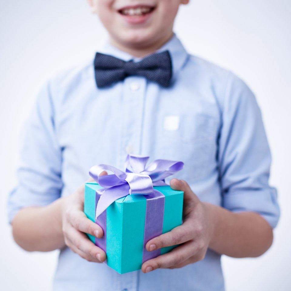 Children gifts  boy holding a gift box