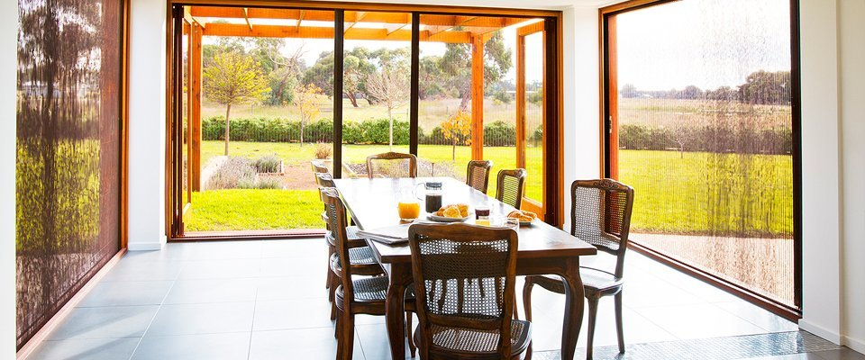 Open air dining room with BRIO 612 pleated insect screen Marin, CA